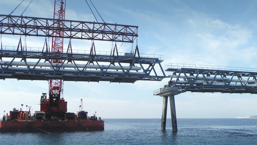 Marteam - Construction of Jetty:Transportation with barges: 47 Trestles, 12 units of Platform & 14 Loading Arms. Lifting & Installing the Trestles onto the circular pile foundations & concrete racks